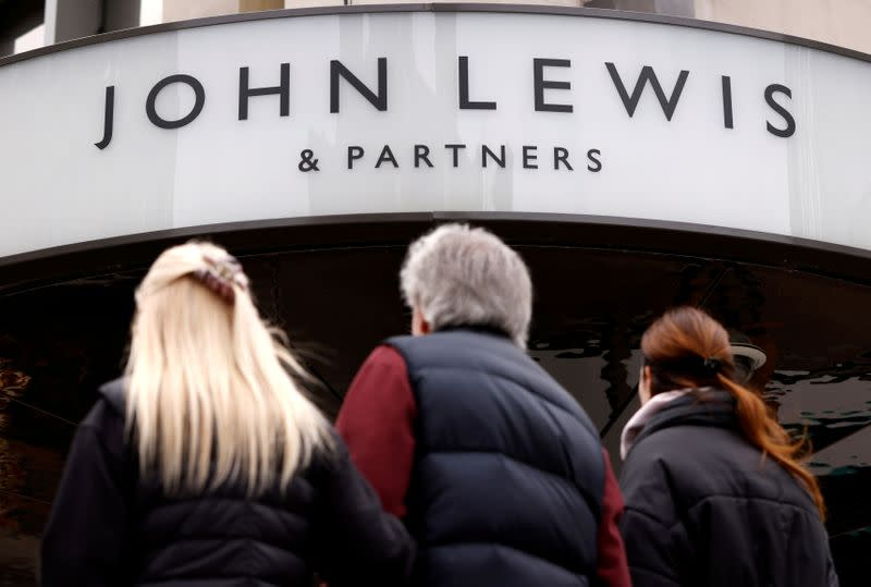 FILE PHOTO: People walk past a temporarily closed John Lewis department store on Oxford Street in London