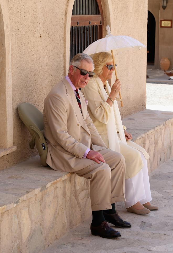 NIZWA, OMAN - MARCH 18:  Prince Charles, Prince of Wales and Camilla, Duchess of Cornwall take a break as they visit Nizwa Fort on the eighth day of a tour of the Middle East on March 18, 2013 in Nizwa, Oman. The Royal couple are on the fourth and final leg of a tour of the Middle East taking in Jordan, Qatar, Saudia Arabia and Oman.  (Photo by Chris Jackson/Getty Images)