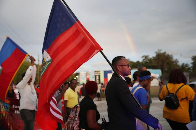 People in Miami march with the Haitian flag on Friday to recognize the anniversary of the country's devastating 2010 earthquake. (Photo: Getty Images)