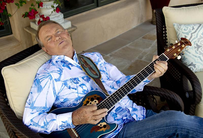 """This July 27, 2011 photo shows musician Glen Campbell in Malibu, Calif.  .  Campbell, who was diagnosed with Alzheimer's disease is planning a farewell tour before retiring from the music.  Campbell is canceling his tour of Australia and New Zealand with Kenny Rogers next month for health reasons. A spokeswoman says Campbell is not up for """"the very long flight that it would require."""" The 76-year-old is battling Alzheimer's disease. It would have been Campbell's last international stop on his """"Goodbye Tour."""" (AP Photo/Matt Sayles)"""