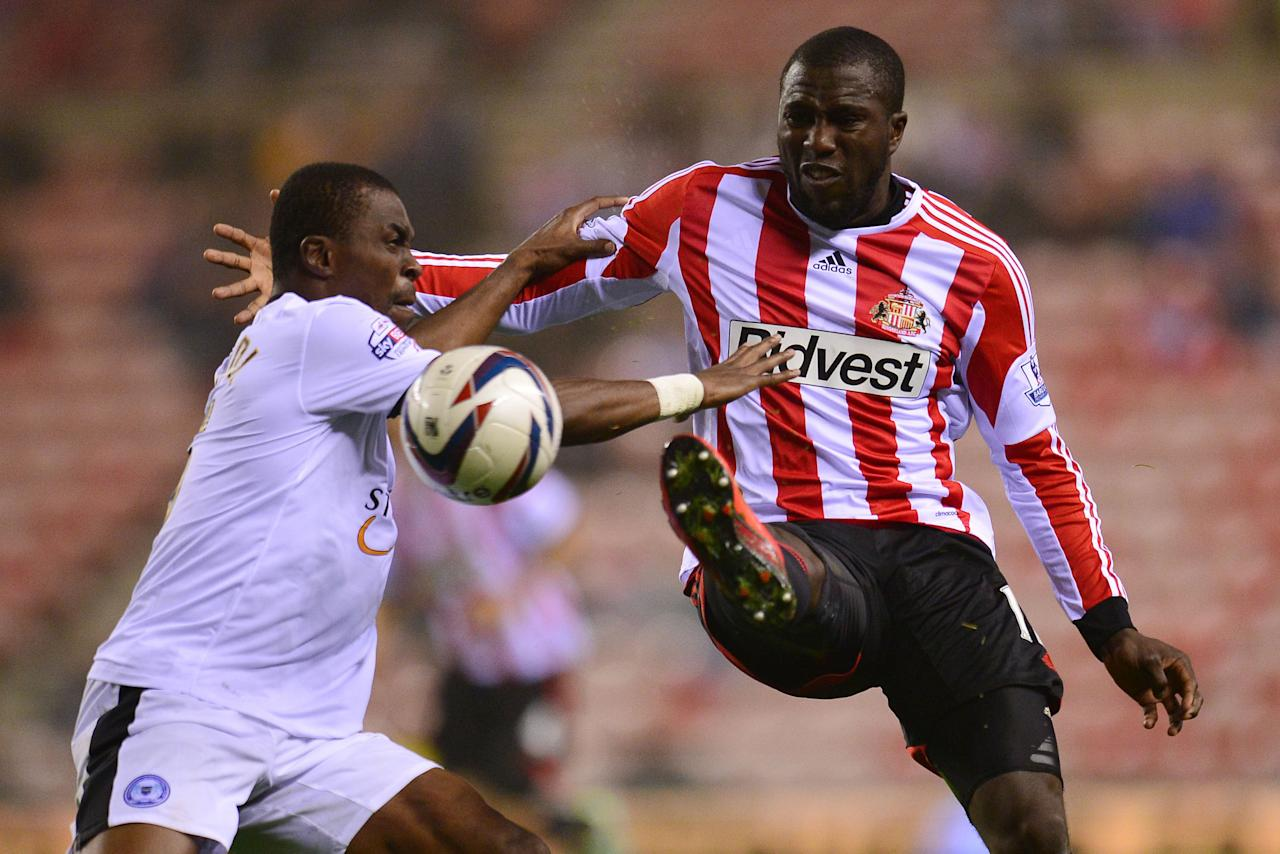 Sunderland's Jozy Altidore (right) and Peterborough United's Gabriel Zakuani during the Capital One Cup, Third round match at the Stadium of Light, Sunderland.