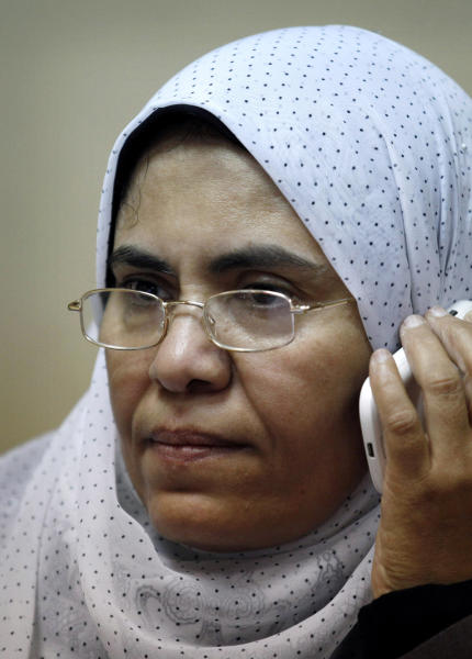 In this Thursday, Oct. 4, 2012 photo, Sabah al-Saqari, 49, a senior member of the Freedom and Justice Party, the political arm of the Muslim Brotherhood, works at her office in the FJP's headquarters in Cairo, Egypt. For the first time, a woman is running for the leadership of the political party of the Muslim Brotherhood, Egypt's most powerful Islamist group. Sabah al-Saqari says she wants to increase female participation in politics and even defends a woman's right to run for president, a stance her organization rejects. But liberals who fear Islamist rule will set back women's rights say her candidacy is just an attempt by the Brotherhood to improve its image. (AP Photo/Nasser Nasser)
