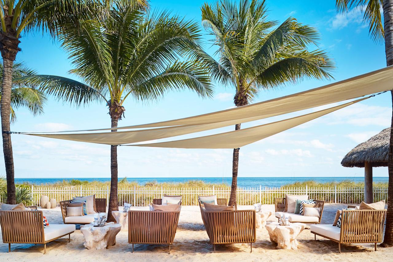 """<p>While the rest of the beaches in Miami tend to attract crowds, the private beach at <a href=""""http://www.ritzcarlton.com/en/hotels/miami/key-biscayne"""" target=""""_blank"""">The Ritz-Carlton</a> in Key Biscayne feels like a world away from the bright lights of the Magic City. Families rave about the resort's Ritz Kids program that features coastal activities from Jean-Michel Cousteau's Ocean Futures Society. Adults will love the impressive tequila selection at RUMBAR, margaritas at the Mexican-style Cantina Beach, champagne and rosé at Dune, and classic cocktails with a Floridian twist at Lightkeepers. <em>455 Grand Bay Drive, Key Biscayne, FL 33149</em></p>"""
