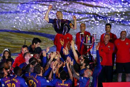 Barcelona's Andres Iniesta and team mates celebrate after the match. REUTERS/Albert Gea