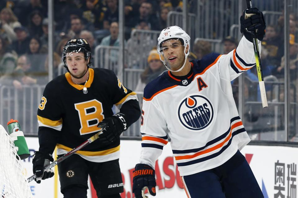 Edmonton Oilers' Darnell Nurse (25) celebrates his goal in front of Boston Bruins' Charlie McAvoy (73) during the second period on an NHL hockey game in Boston, Saturday, Jan. 4, 2020. (AP Photo/Michael Dwyer)