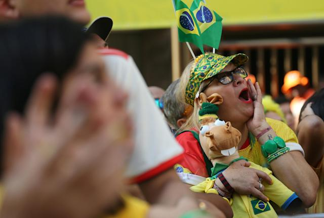 Soccer Football - World Cup Group E - Brazil vs Costa Rica - Rio de Janeiro, Brazil - June 22, 2018 - Fans react during the match as they watch the broadcast. REUTERS/Sergio Moraes