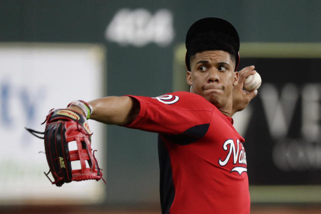 Washington Nationals left fielder Juan Soto warms up during batting practice for baseball's World Series Monday, Oct. 21, 2019, in Houston. The Houston Astros face the Washington Nationals in Game 1 on Tuesday. (AP Photo/Eric Gay)