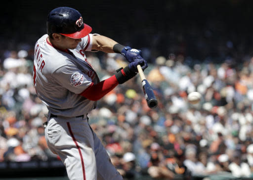 Washington Nationals' Trea Turner drives in two runs with a single against the San Francisco Giants during the fifth inning of a baseball game Wednesday, April 25, 2018, in San Francisco. (AP Photo/Marcio Jose Sanchez)
