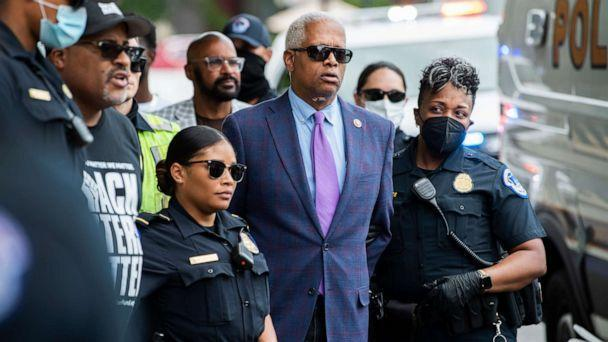 PHOTO: Rep. Hank Johnson and Cliff Albright, second from left, co-founder of Black Voters Matter, are arrested during a protest to support voting rights outside of Hart Building in Washington, July 22, 2021. (Tom Williams/CQ-Roll Call via Getty Images)