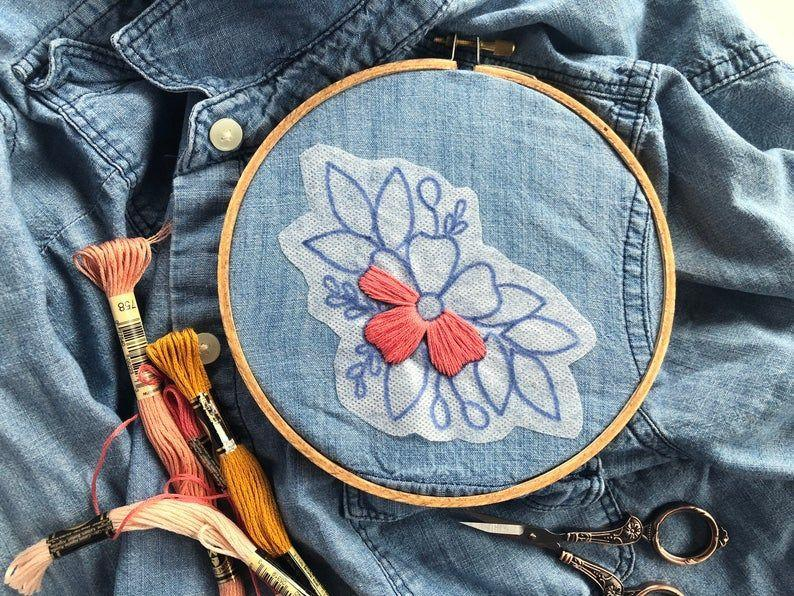 """<p><strong>floralsandfloss</strong></p><p>etsy.com</p><p><strong>$14.96</strong></p><p><a href=""""https://go.redirectingat.com?id=74968X1596630&url=https%3A%2F%2Fwww.etsy.com%2Flisting%2F774270525%2Fstick-and-stitch-embroidery-designs&sref=https%3A%2F%2Fwww.oprahdaily.com%2Flife%2Fg37101463%2Fbest-embroidery-kits%2F"""" rel=""""nofollow noopener"""" target=""""_blank"""" data-ylk=""""slk:SHOP NOW"""" class=""""link rapid-noclick-resp"""">SHOP NOW</a></p><p>This embroidery kit has a very practical application. The designs, which aren't too big to overwhelm, stick onto fabric, so you can stitch floral designs on denim, pillow covers, and more. Simply peel the backing off of the design, stick to the desired area, embroider, and then wash the pattern away with warm water. </p>"""