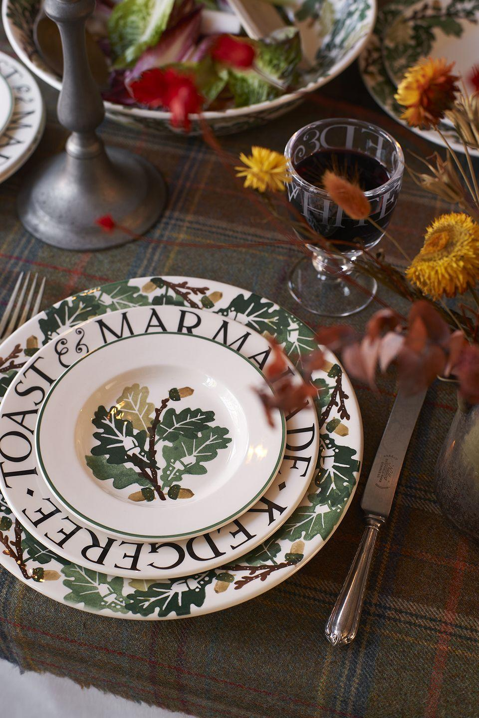 """<p>Elevate your dinnerware with Emma Bridgewater's autumnal-inspired plate set. It's right at the top of our wish list...</p><p>'Britain's mild damp climate is kind to trees, and there is no tree more magnificent than the Oak,' the team at Emma Bridgewater say. 'New for this autumn, the Oak collection features the mighty tree's foliage in a sponge pattern covering mugs, plates, platters, bowls and jam-jar vases.'</p><p><a class=""""link rapid-noclick-resp"""" href=""""https://go.redirectingat.com?id=127X1599956&url=https%3A%2F%2Fwww.emmabridgewater.co.uk%2Fcollections%2Foak&sref=https%3A%2F%2Fwww.housebeautiful.com%2Fuk%2Flifestyle%2Fshopping%2Fg37527696%2Femma-bridgewater-autumn-range%2F"""" rel=""""nofollow noopener"""" target=""""_blank"""" data-ylk=""""slk:SHOP THE RANGE"""">SHOP THE RANGE</a></p>"""