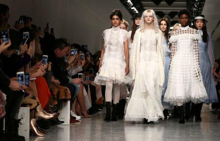 FILE PHOTO: Models present creations during the Bora Aksu catwalk show during London Fashion Week in London