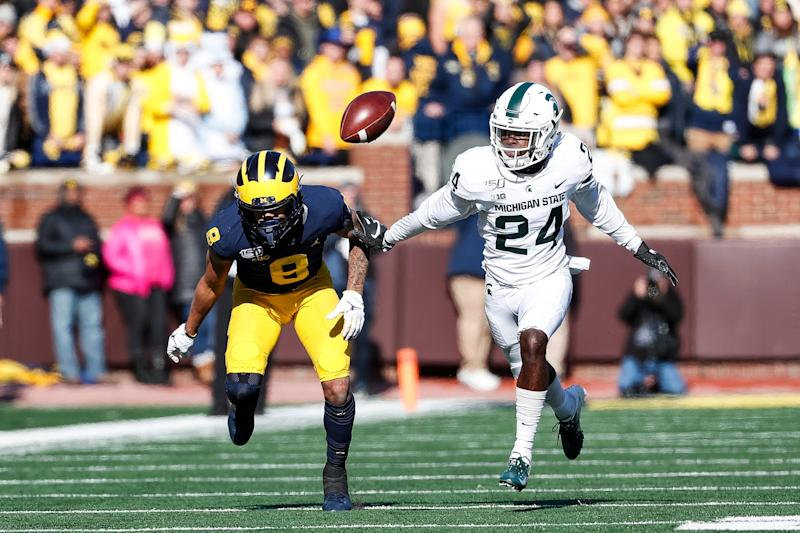 Michigan wide receiver Ronnie Bell misses a pass behind Michigan State cornerback Tre Person during the first half at Michigan Stadium on Saturday, Nov. 16, 2019.