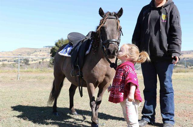 Hope, an animal lover like her mother, was often photographed with horses. Picture: Facebook