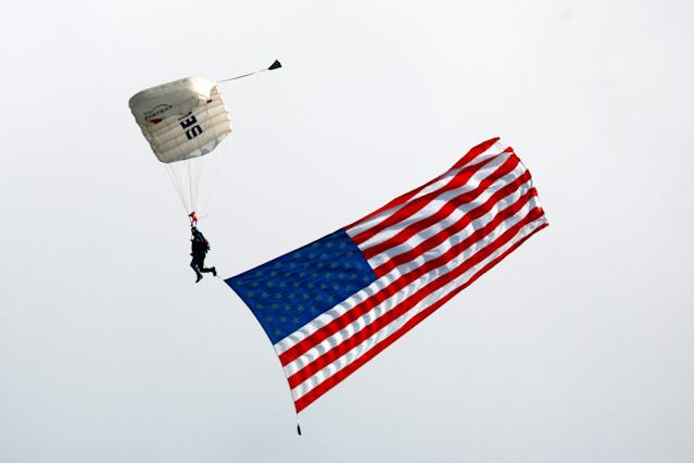 A wind-swept skydiver at Sunday's NASCAR race missed his mark and almost ended up in the stands. (Getty)