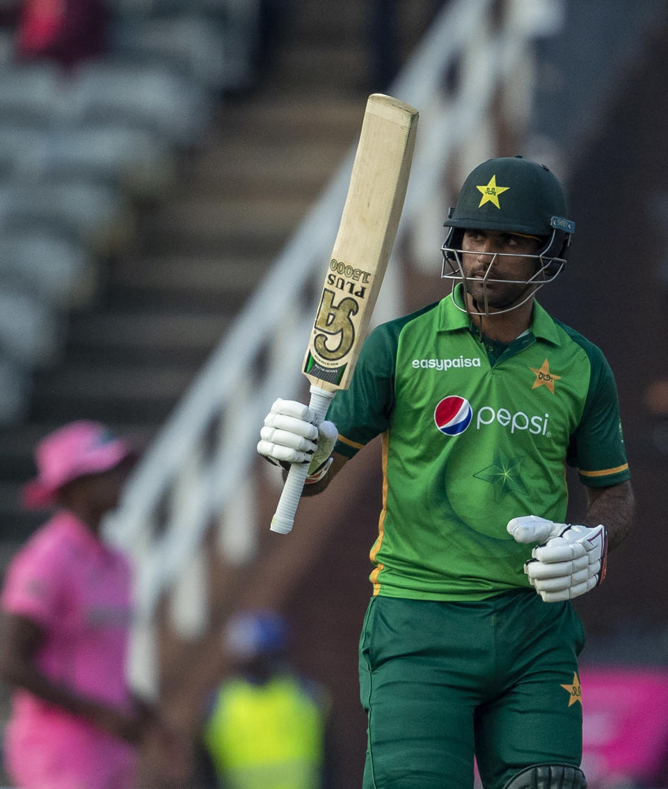 Pakistan's batsman Fakhar Zaman raises his bat to celebrate scoring a century during the second One Day International cricket match between South Africa and Pakistan at the Wanderers stadium in Johannesburg, South Africa, Sunday, April 4, 2021. (AP Photo/Themba Hadebe)