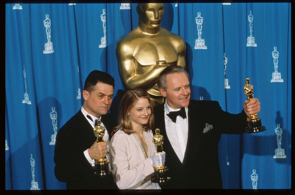 """120528 04: Best Actor recipient Anthony Hopkins, Best Actress recipient Jodie Foster and Best Director recipient Jonathan Demme hold their Oscars at the 64th annual Academy Awards March 30, 1992 in Los Angeles, CA. The Academy of Motion Picture Arts and Sciences awarded five Oscars to the film """"Silence of the Lambs."""" (Photo by John Barr/Liaison)"""