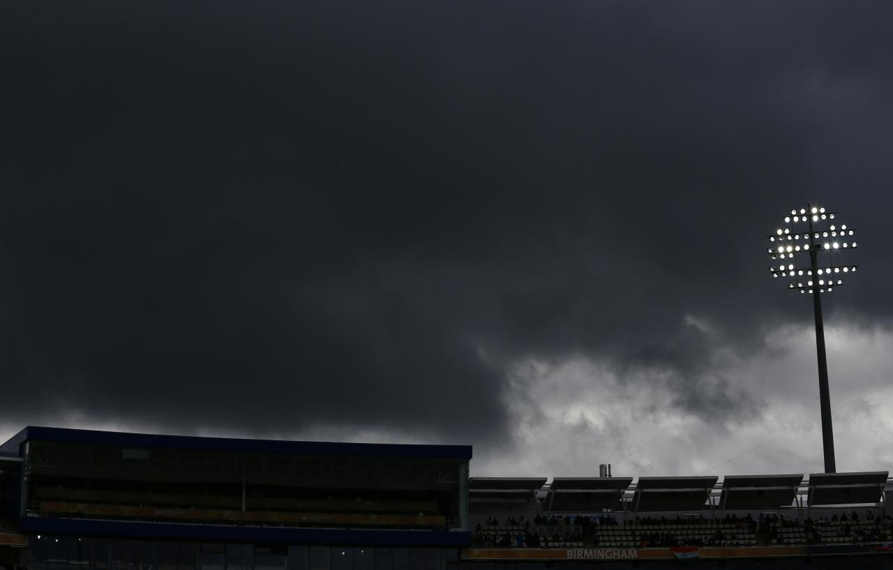 Rain clouds gather during England's ICC Champions Trophy final match against India at Edgbaston cricket ground in Birmingham, central England, June 23, 2013. REUTERS/Darren Staples (BRITAIN - Tags: SPORT CRICKET ENVIRONMENT)