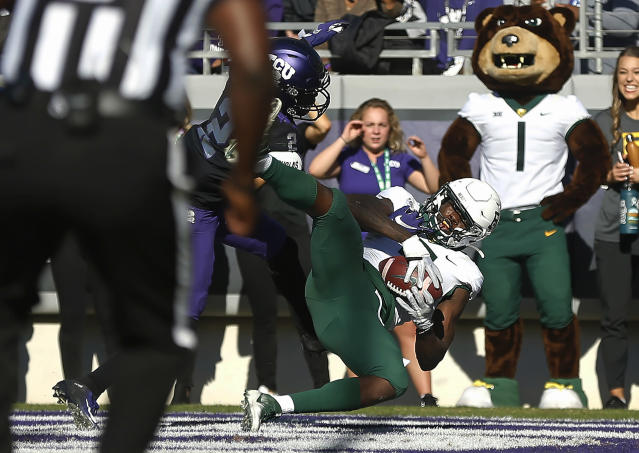 Baylor wide receiver Denzel Mims (5) catches a touchdown pass as TCU cornerback Kee'yon Stewart (2) defends during the third overtime of an NCAA college football game, Saturday, Nov. 9, 2019, in Fort Worth, Texas. Baylor won 29-23 in triple overtime. (AP Photo/Ron Jenkins)