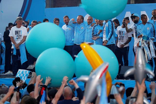 Soccer Football - Premier League - Manchester City Premier League Title Winners Parade - Manchester, Britain - May 14, 2018 Manchester City manager Pep Guardiola celebrates with staff and team mates during the parade Action Images via Reuters/Andrew Boyers