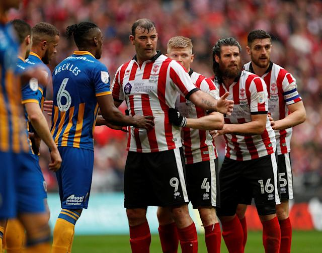"Soccer Football - Checkatrade Trophy Final - Lincoln City vs Shrewsbury Town - Wembley Stadium, London, Britain - April 8, 2018 Lincoln City's Matt Rhead, Elliott Whitehouse, Michael Bostwick and Luke Waterfall line up before an attack Action Images/Andrew Boyers EDITORIAL USE ONLY. No use with unauthorized audio, video, data, fixture lists, club/league logos or ""live"" services. Online in-match use limited to 75 images, no video emulation. No use in betting, games or single club/league/player publications. Please contact your account representative for further details."