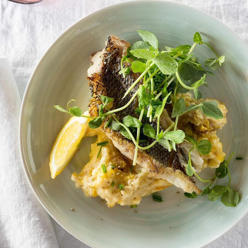 "<p>In this healthy seared fish recipe, salting the fish's skin draws out the moisture, which helps it get nice and crispy in the hot pan. Here, black sea bass is served on top of polenta that's enriched with a buttery summer squash puree. Garnish with lemon wedges, if desired. <a href=""http://www.eatingwell.com/recipe/254603/black-sea-bass-with-summer-squash-polenta/"" rel=""nofollow noopener"" target=""_blank"" data-ylk=""slk:View recipe"" class=""link rapid-noclick-resp""> View recipe </a></p>"