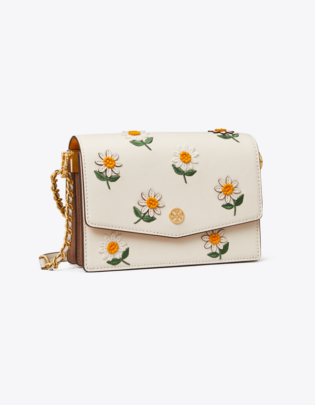 """Florals for spring? We know, we know. But it's hard not to smile over this daisy bag from <a href=""""https://fave.co/2PO7DKw"""" rel=""""nofollow"""" target=""""_blank"""">Tory Burch</a>. $398, Tory Burch. <a href=""""https://www.toryburch.com/robinson-embroidered-mini-shoulder-bag/64401.html"""">Get it now!</a>"""