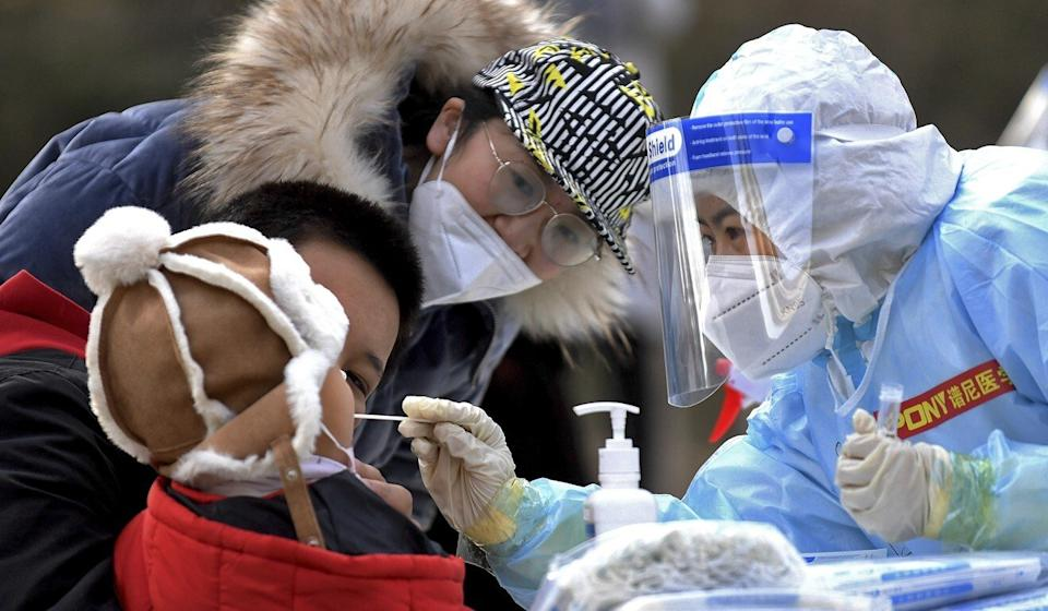 A swab is taken from a child in Shijiazhuang on Sunday. A new round of mass testing will begin in the city of 11 million on Tuesday. Photo: AP