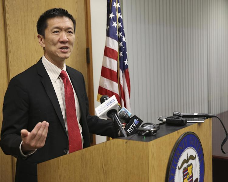 Hawaii Attorney General Douglas Chin speaks at a news conference Thursday, March 9, 2107, in Honolulu. Chin's office filed an amended lawsuit against President Donald Trump's revised travel ban. (AP Photo/Marco Garcia)