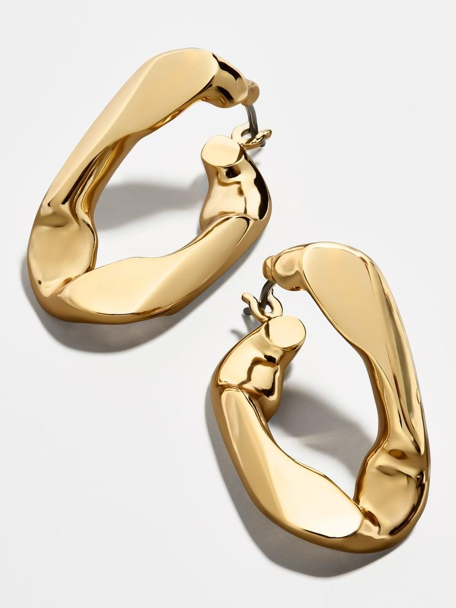 "<p><a href=""https://www.popsugar.com/buy/Michel-Large-Curb-Chain-Hoop-Earrings-570399?p_name=Michel%20Large%20Curb%20Chain%20Hoop%20Earrings&retailer=baublebar.com&pid=570399&price=20&evar1=fab%3Aus&evar9=47437458&evar98=https%3A%2F%2Fwww.popsugar.com%2Fphoto-gallery%2F47437458%2Fimage%2F47440717%2FMichel-Large-Curb-Chain-Hoop-Earrings&list1=shopping%2Cjewelry%2Caccessories%2Cbaublebar%2Cspring%20fashion%2Csale%20shopping%2Cfashion%20shopping&prop13=api&pdata=1"" class=""link rapid-noclick-resp"" rel=""nofollow noopener"" target=""_blank"" data-ylk=""slk:Michel Large Curb Chain Hoop Earrings"">Michel Large Curb Chain Hoop Earrings</a> ($20, originally $44)</p>"