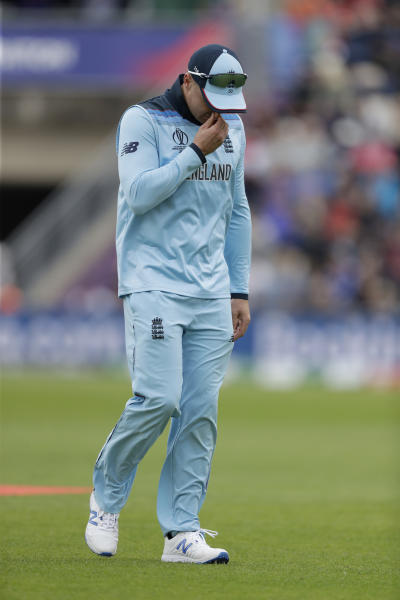 England's Jason Roy walks off the field of play with a leg injury during the Cricket World Cup match between England and West Indies at the Hampshire Bowl in Southampton, England, Friday, June 14, 2019. (AP Photo/Matt Dunham)