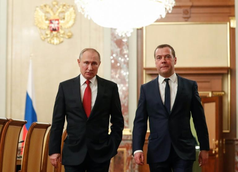 Russian President Vladimir Putin and Dmitry Medvedev last week (AFP Photo/Dmitry ASTAKHOV)