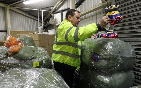 Border Force officer Robert Martin with children's toys which are amongst the goods seized - Credit: Gareth Fuller/PA