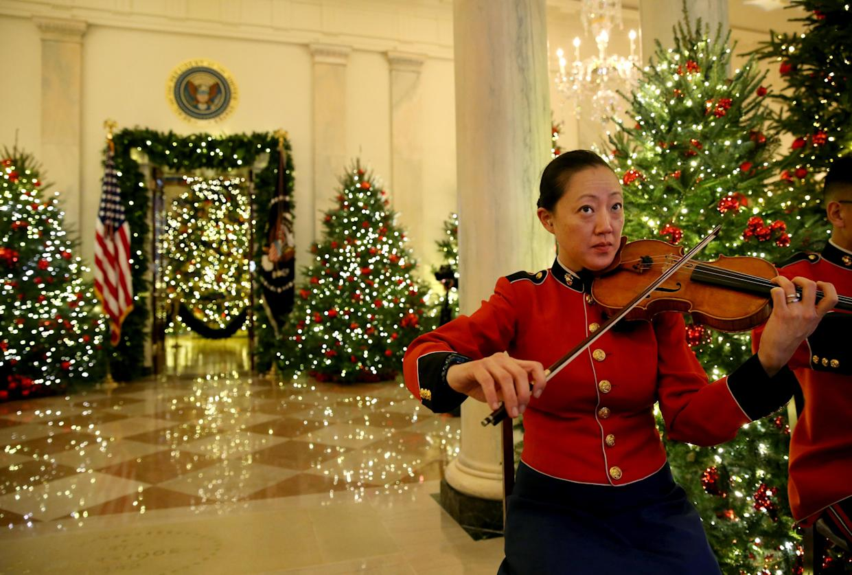 A member of the President's Own Marine Band plays during the 2018 Christmas Press Preview at the White House in Washington, D.C., Nov. 26, 2018. (Photo: Leah Millis/Reuters)