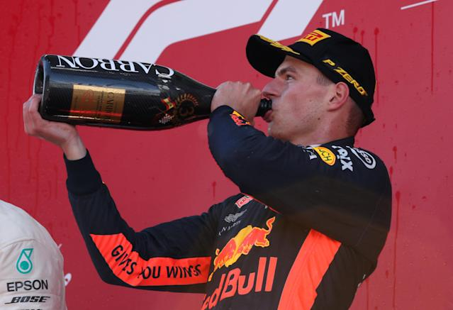 Formula One F1 - Spanish Grand Prix - Circuit de Barcelona-Catalunya, Barcelona, Spain - May 13, 2018 Red Bull's Max Verstappen drinks champagne as he celebrates on the podium after finishing in third place REUTERS/Albert Gea