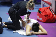 Margarita Gasparyan of Russia receives medical attention during the St. Petersburg Ladies Trophy 2021 tennis tournament final match against Daria Kasatkina of Russia in St.Petersburg, Russia, Sunday, March 21, 2021. (AP Photo/Dmitri Lovetsky)