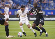 Atlanta United midfielder Ezequiel Barco fends off CF Montreal defender Kamal Miller, right, during the first half of an MLS soccer match Wednesday, Aug. 4, 2021, in Montreal. (Paul Chiasson/The Canadian Press via AP)