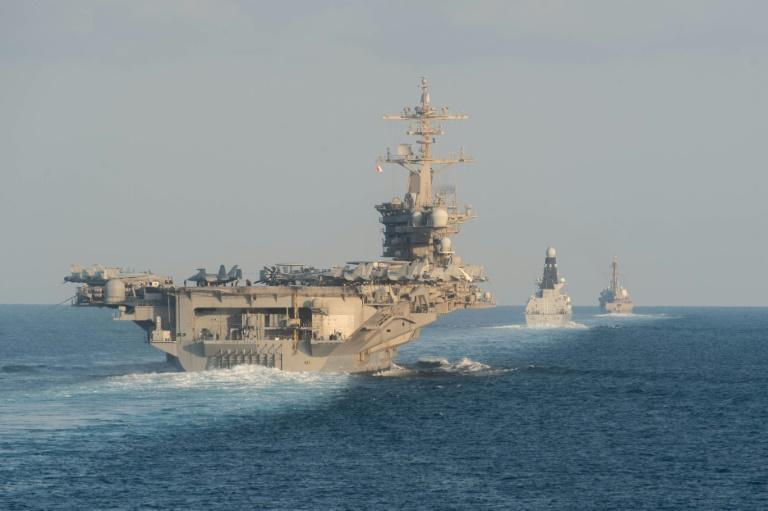 The aircraft carrier USS Abraham Lincoln and its strike group traveled through the Strait of Hormuz in a US show of force in the Gulf (AFP Photo/Zachary PEARSON)