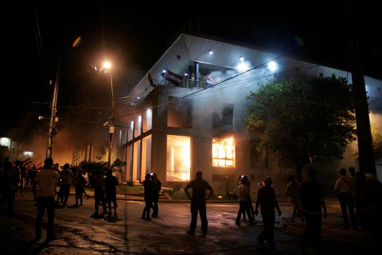 Paraguayan protesters broke into the Congress ransacking lawmakers' offices and starting fires after senators approved a proposal to allow the president to run for reelection