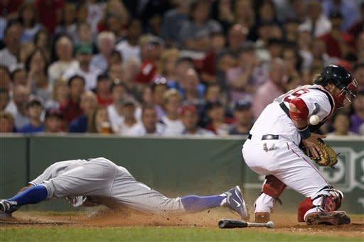 Toronto Blue Jays' Rajai Davis, left, is safe at home plate as Boston Red Sox's Jarrod Saltalamacchia, right, bobbles the throw on a single by the Blue Jays' Brett Lawrie in the seventh inning of a baseball game in Boston, Saturday, July 21, 2012. (AP Photo/Michael Dwyer)