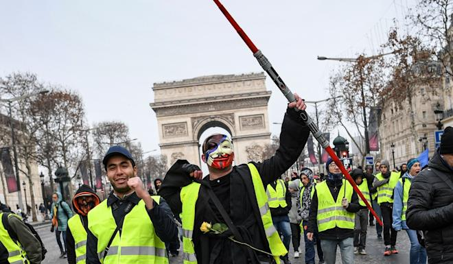 Angry about a fuel tax hike, French protesters wearing high-visibility yellow vests took to the iconic Arc de Triomphe in Paris last November. Photo: AFP