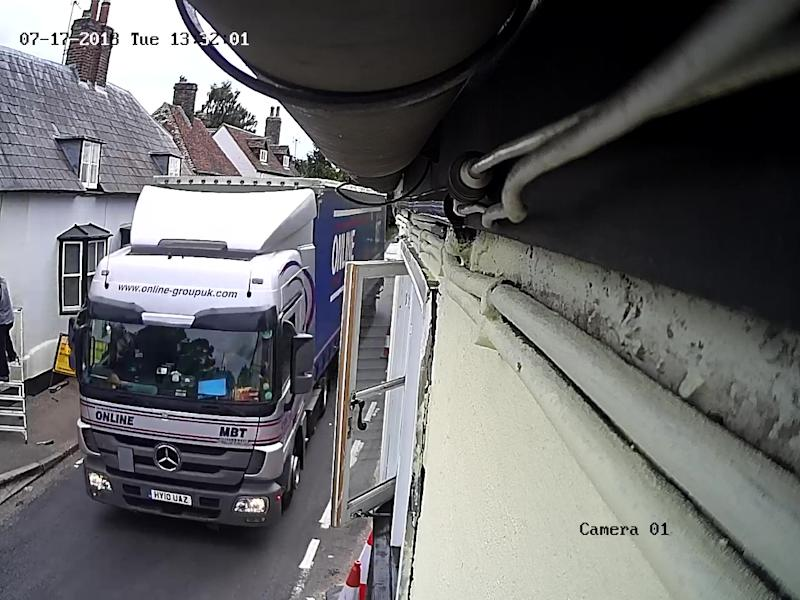 CCTV of one of the lorries that have struck Mark Kilbey's grade II listed cottage. He says it has happened eight times in the past year. (SWNS)