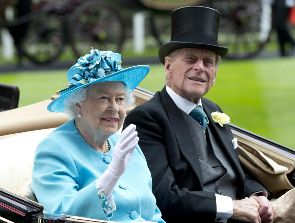 FILE - In this file photo dated Thursday, June, 19, 2014, Britain's Queen Elizabeth II, and Prince Philip arrive by carriage in the parade ring on the third day of the Royal Ascot horse racing meeting, at Ascot, England. In the TV program 'Prince Philip: The Royal Family Remembers' released late Saturday Sept. 18, 2021, members of the royal family have spoken admiringly of the late Duke of Edinburgh's barbecuing skills. (AP Photo/Alastair Grant, FILE)