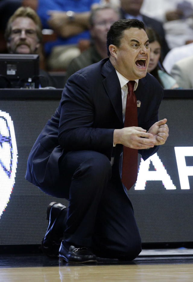 Arizona head coach Sean Miller yells during the first half in a regional final NCAA college basketball tournament game against Wisconsin, Saturday, March 29, 2014, in Anaheim, Calif. (AP Photo/Jae C. Hong)