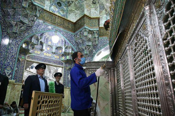 PHOTO: Iranian workers disinfect the Shrine of Fatima Masumeh in Qom, Iran, on February 25, 2020, to prevent the spread of the novel coronavirus which has reached the country. (Mehdi Marizad/FARS NEWS AGENCY/AFP via Getty Images)