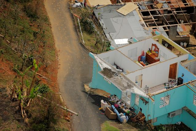 <p>The interior contents of a home are seen from the air during recovery efforts following Hurricane Maria near Utuado, Puerto Rico, Oct. 10, 2017. (Photo: Lucas Jackson/Reuters) </p>