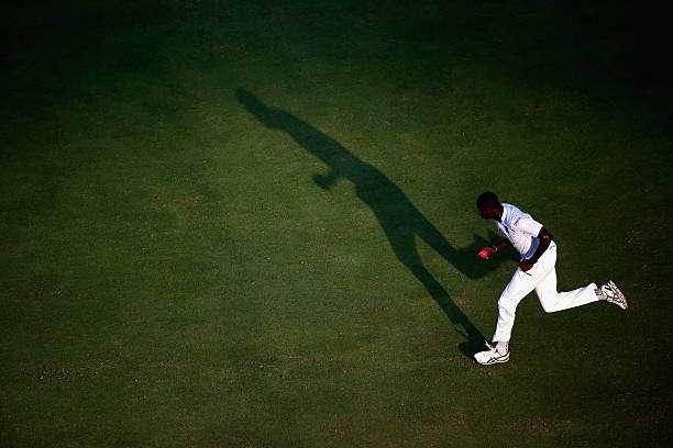 DUBAI, UNITED ARAB EMIRATES - OCTOBER 13: Jason Holder of West Indies bowls during Day One of the First Test between Pakistan and West Indies at Dubai International Cricket Ground on October 13, 2016 in Dubai, United Arab Emirates. (Photo by Francois Nel/Getty Images)