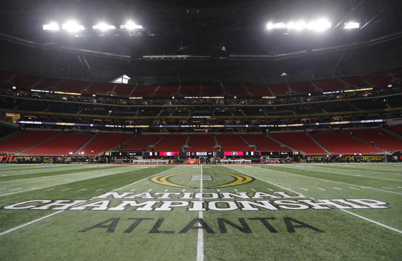FILE - In this Jan. 8, 2018, file photo, the championship logo is seen on the field at Mercedes-Benz Stadium before the NCAA college football playoff championship game between Georgia and Alabama in Atlanta. There are more bowl games scheduled for the coming season than ever before in major college football: 42, not including the College Football Playoff championship. College football leaders are in the process of piecing together plans to attempt to play a regular season during the COVID-19 pandemic. If it is even possible, everyone anticipates there will be disruptions, added expenses and loads of stress just to get through it.(AP Photo/David Goldman)