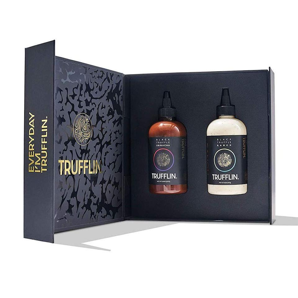 """<p><strong>Trufflin</strong></p><p>trufflin-nyc.com</p><p><strong>$59.99</strong></p><p><a href=""""https://trufflin-nyc.com/products/black-truffle-ranch-sriracha-w-real-truffle"""" rel=""""nofollow noopener"""" target=""""_blank"""" data-ylk=""""slk:Shop Now"""" class=""""link rapid-noclick-resp"""">Shop Now</a></p><p>Featured as one of <a href=""""https://www.bestproducts.com/lifestyle/g3434/oprahs-favorite-things/"""" rel=""""nofollow noopener"""" target=""""_blank"""" data-ylk=""""slk:Oprah's Favorite Things"""" class=""""link rapid-noclick-resp"""">Oprah's Favorite Things</a> in 2020, this black-truffle-infused saucy duo makes everything taste fancy. This gift set includes a hot truffle Sriracha and a more mellow truffle ranch, so whether your recipient prefers spicy or savory, there's something in here for them to enjoy.</p><p>This is one major step beyond your basic food gift basket, and Lady O would agree.</p>"""