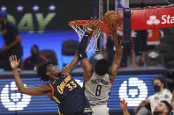 Washington Wizards forward Rui Hachimura, right, shoots against Golden State Warriors center James Wiseman during the first half of an NBA basketball game in San Francisco, Friday, April 9, 2021. (AP Photo/Jed Jacobsohn)